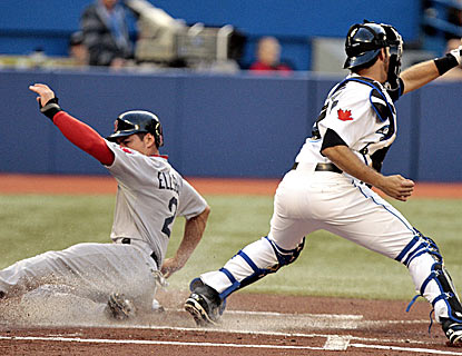 Jacoby Ellsbury slides home safe to score one of the Red Sox's 14 runs in their rout of the Blue Jays. (Getty Images)