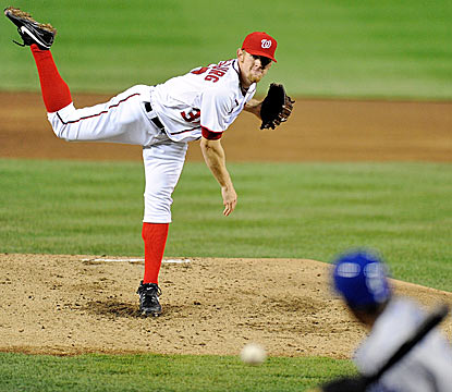 Stephen Strasburg throws 40 of his 56 pitches for strikes, and whiffs four Dodgers in five innings of shutout ball. (AP)