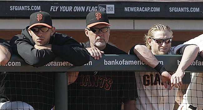 Watching the Giants office has been difficult for Bruce Bochy and Co. this season. (AP)