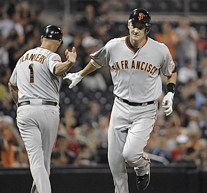 San Francisco's Brett Pill rounds third and heads home after connecting in his first MLB plate appearance.  (Getty Images)