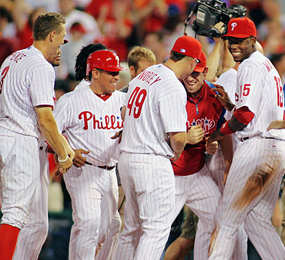 Phillies players celebrate Ross Gload's walk-off winning pinch hit RBI in the bottom of the ninth. (Getty Images)
