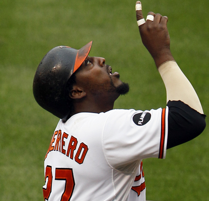Vladimir Guerrero reacts after hitting a solo homer in the first inning. Guerrero has scored four runs in his last four games. (AP)