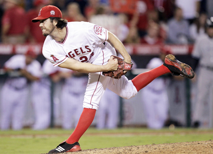 Dan Haren retires 18 straight while going the distance for the 15th time in 253 career starts.  (Getty Images)
