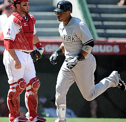 Robinson Cano crosses home plate after hitting a solo shot in the fourth inning vs. the Angels. (Getty Images)
