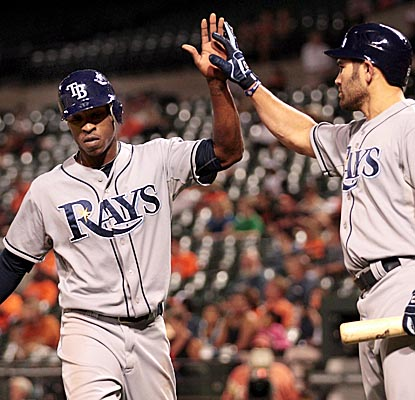 B.J. Upton (left) helps keep the Rays' wild-card hopes alive, going 4 for 4 with a walk vs. the O's. (Getty Images)