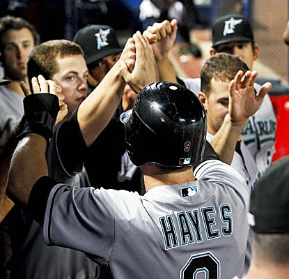 The Marlins welcome Brett Hayes into the dugout after teammate Mike Stanton brings him home the win. (US Presswire)