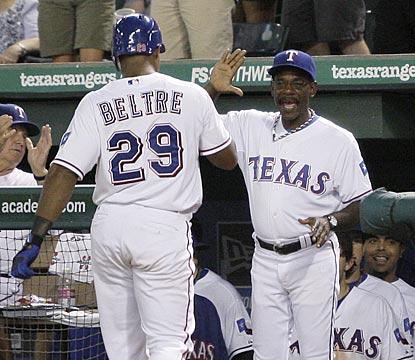 Ron Washington greets Adrian Beltre after the slugger leads off the seventh inning with his 24th home run of the season.  (AP)