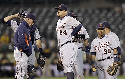Jim Leyland, Miguel Cabrera and the rest of Tigers will have to wait until at least Friday to party in Oakland.  (AP)