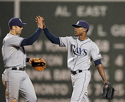Those AL East standings get tighter as Evan Longoria and B.J. Upton celebrate another victory against Boston.  (Getty Images)