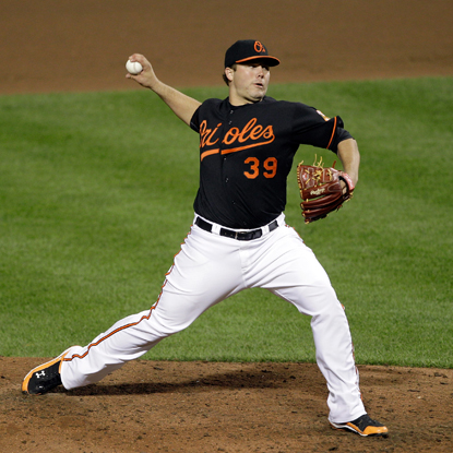 Tommy Hunter gives up seven hits, strikes out five and walks two while throwing seven scoreless innings.  (Getty Images)
