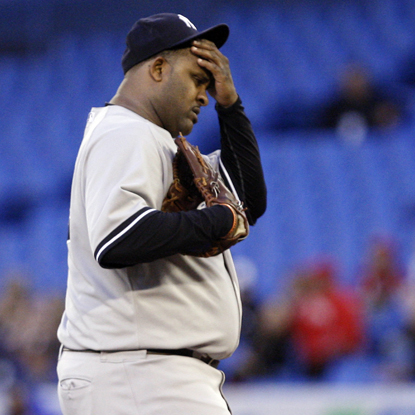 Ahead 3-1 in the fifth, CC Sabathia reacts after allowing a critical three-run double to Adam Lind. (Getty Images)