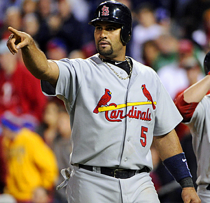 Albert Pujols celebrates after scoring on Adron Chambers' single in the 11th inning against the Phillies. (US Presswire)
