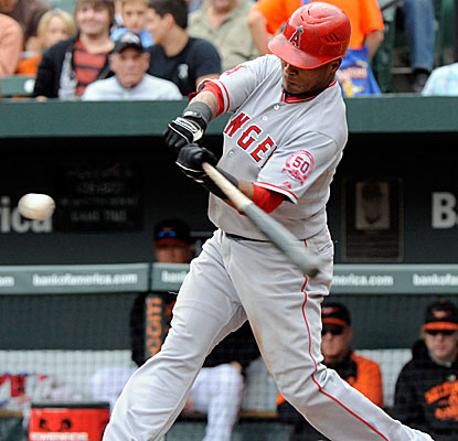 Erick Aybar connects for a two-run homer in the fourth inning after smashing a solo shot in the third. (Getty Images)
