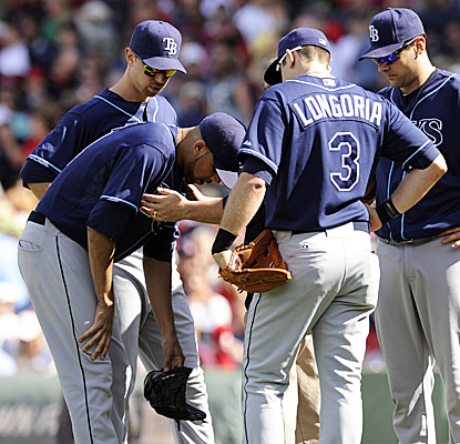 Rays starter David Price takes a breather after a Red Sox line drive hit his chest in the third inning at Fenway. (US Presswire)