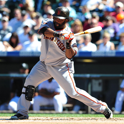 Pablo Sandoval helps the Giants rout the Rockies by blasting two home runs in an eight-run fourth inning.  (Getty Images)
