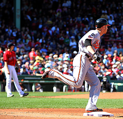 The Orioles' Nolan Reimold rounds the bases after hitting a home run in the third inning at Fenway Park. (Getty Images)