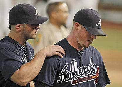 Braves second baseman Dan Uggla consoles closer Craig Kimbrel after Florida's Omar Infante ends the game in stunning fashion.  (AP)