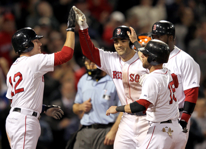 Conor Jackson's (center) grand slam caps a much-needed offensive burst that helps Boston split their doubleheader. (Getty Images)