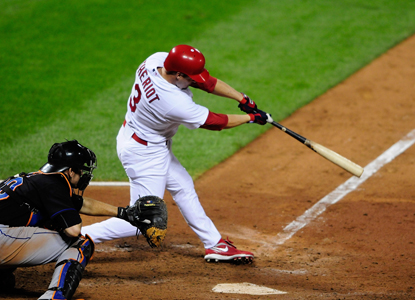 With the bases loaded in the bottom of the seventh, Ryan Theriot hammers a go-ahead double. (Getty Images)