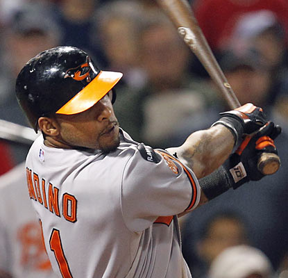 Robert Andino hurts the Red Sox with a three-run double in the eighth inning, which puts the O's ahead for good. (AP)