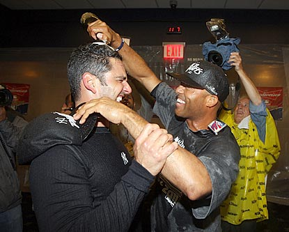 Two of the Yankees' old guard -- Jorge Posada and Mariano Rivera -- celebrate another American League East championship.  (Getty Images)