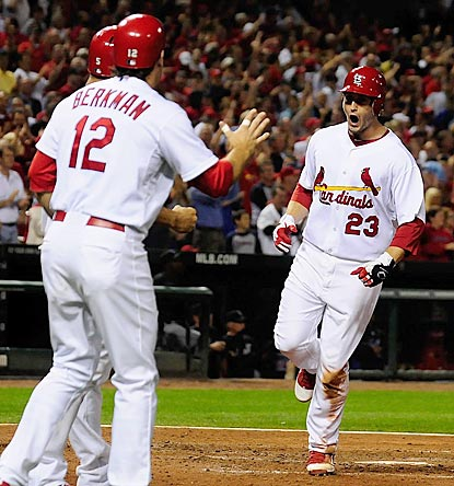 David Freese is stoked after his three-run blast puts St. Louis ahead to stay and brings it closer to the wild-card lead.  (US Presswire)