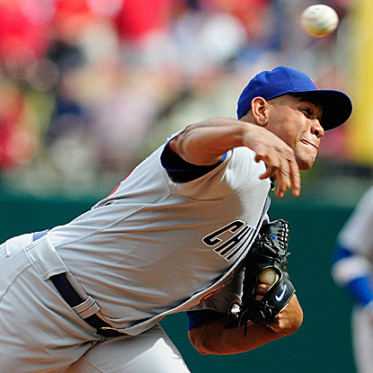 Carlos Marmol blows his 10th save in 44 opportunities, issuing a base-loaded walk and a game-ending wild pitch. (AP)