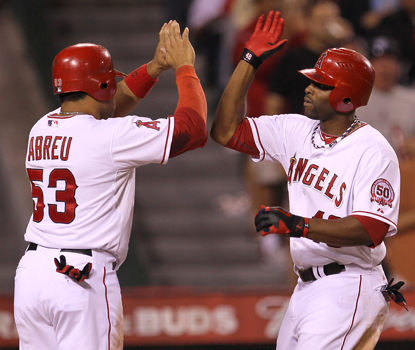 Torii Hunter (right) celebrates his HR with teammate Bobby Abreu before finishing the game with three RBI. (Getty Images)