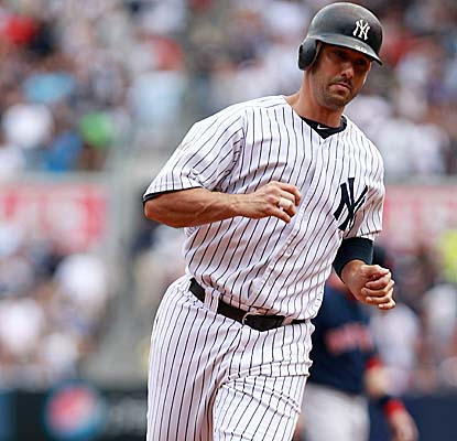 Jorge Posada rounds the bases after hitting a two-run homer in the third inning. (Getty Images)