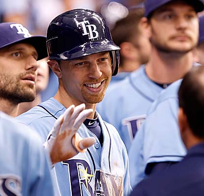 Ben Zobrist is welcomed to the Rays dugout after hitting an inside-the-park home run off Toronto's Brett Cecil. (Getty Images)