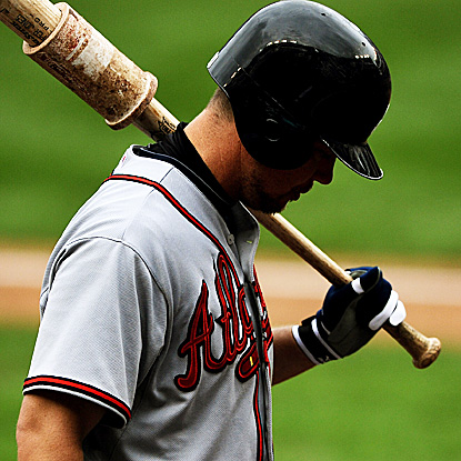 Chipper Jones goes 0 for 4 with a strikeout against the Nationals on Sunday.  The Braves' wild-card lead is down to one game. (AP)