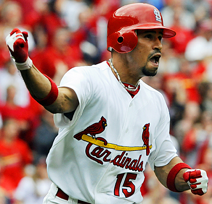 The Cardinals' Rafael Furcal celebrates his home run in the eighth inning against the Cubs. (AP)
