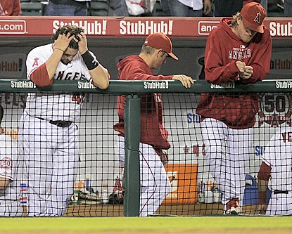 Bobby Wilson (left) and Jered Weaver (right) react after the Angels' gallant fight to get back into the postseason expires.  (AP)