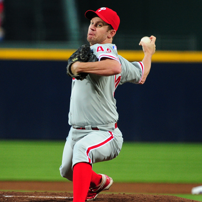 Roy Oswalt gears up for the playoffs by delivering a masterful three-hit outing against the Braves.  (Getty Images)