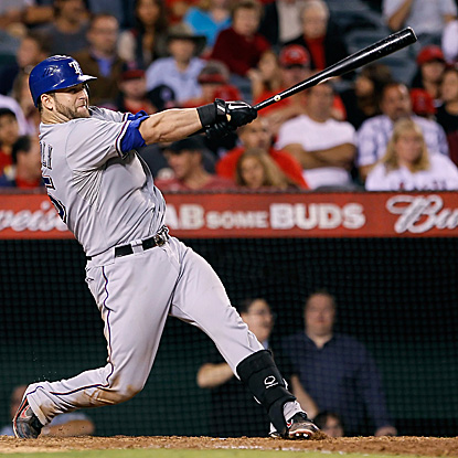 Mike Napoli breaks a 1-1 tie with his fourth homer in two games.  Texas clinches the number two seed. (AP)
