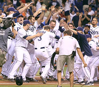 Evan Longoria stomps on home plate before Tampa Bay's jubilant players and fans after his clinching walk-off home run.  (US Presswire)