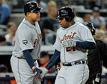 Detroit's Delmon Young celebrates with teammate Miguel Cabrera after hitting a solo home run in the first inning. (Getty Images)