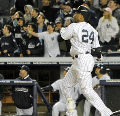 Robinson Cano smacks a grand slam off Detroit's Al Alburquerque to give the Yankees a big cushion in the sixth inning.  (US Presswire)