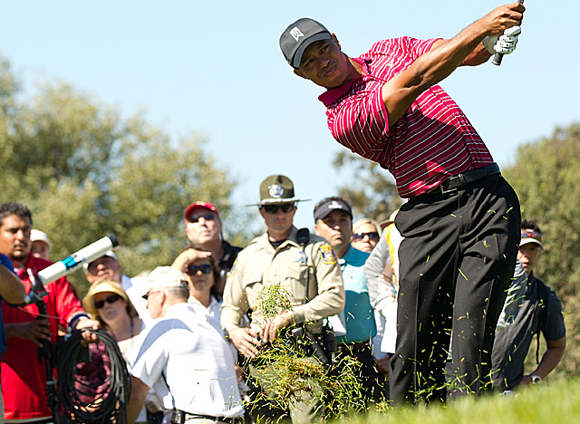 A fairly sizable security contingent keeps an eye on Tiger Woods at the Frys.com Open. (US Presswire)
