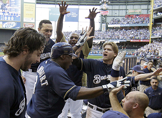 Milwaukee's dugout welcomes Yuniesky Betancourt after his two-run homer in the fifth innning. (AP)