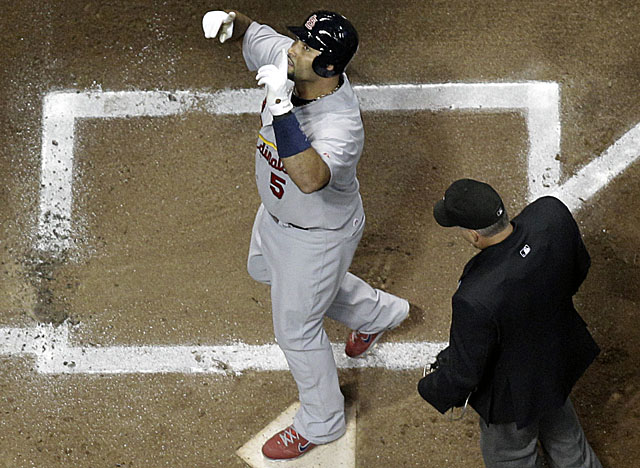 Pujols touches home in the first for what is one of his five RBI for the Cards in Game 2. (AP)
