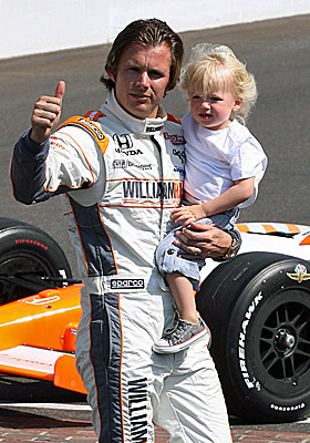 Dan Wheldon carries his son Sebastian after winning the 2011 Indy 500. (US Presswire)