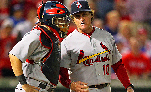 Tony La Russa (right) talks with Yadier Molina after the eighth-inning bullpen mixup. (US Presswire)