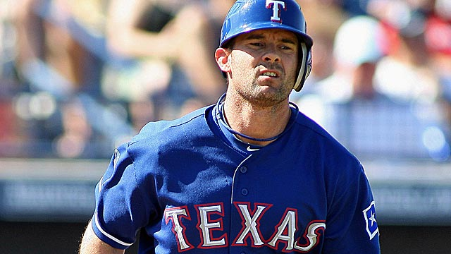 With Adrian Beltre at third, Michael Young will again play all over the diamond. (US Presswire)