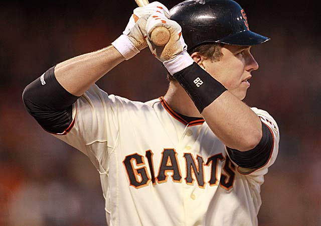 Buster Posey, back for a full season, should help improve the Giants' 86-76 mark of '11. (Getty Images)