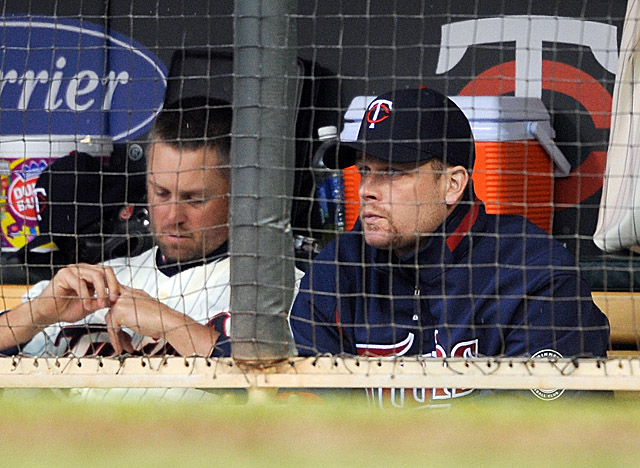 Two concussions in, Morneau (right) is on the cusp of his once-promising career ending. (Getty Images)