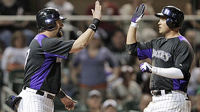 Todd Helton and  Michael Cuddyer are two key veteran pieces on a young, talented team. (AP)