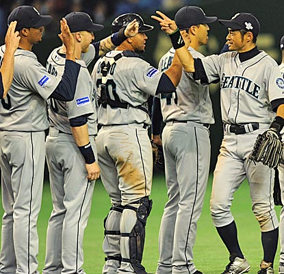 Ichiro celebrates with his Mariners teammates after delivering four hits in front of his Tokyo fans. (Getty Images)