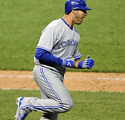 J.P. Arencibia reacts after hitting the go-ahead three-run homer in the top pf the 16th inning.  (US Presswire)