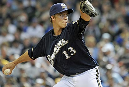 Zack Greinke gives up just three hits over seven innings of work as the Brewers get their first win of 2012.  (Getty Images)